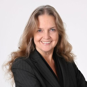 Joan Hammerquist,:Assisting Buyers & Sellers